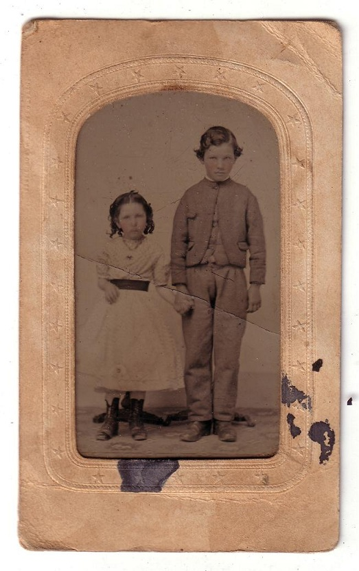 Tin type photo of young girl and boy from the 1860s